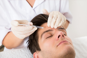 Man receiving Juvederm injection