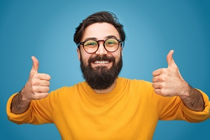 Man giving double thumbs up